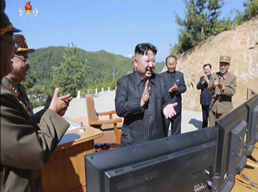 This image made from video of a news bulletin aired by North Korea's KRT on Tuesday, July 4, 2017, shows what was said to be North Korea leader Kim Jong-un, center, applauding after the launch of a Hwasong-14 intercontinental ballistic missile, ICBM, in North Korea's northwest. (KRT via AP Video)