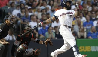 Milwaukee Brewers' Eric Thames hits a home run during the seventh inning of a baseball game against the Baltimore Orioles Tuesday, July 4, 2017, in Milwaukee. (AP Photo/Morry Gash)
