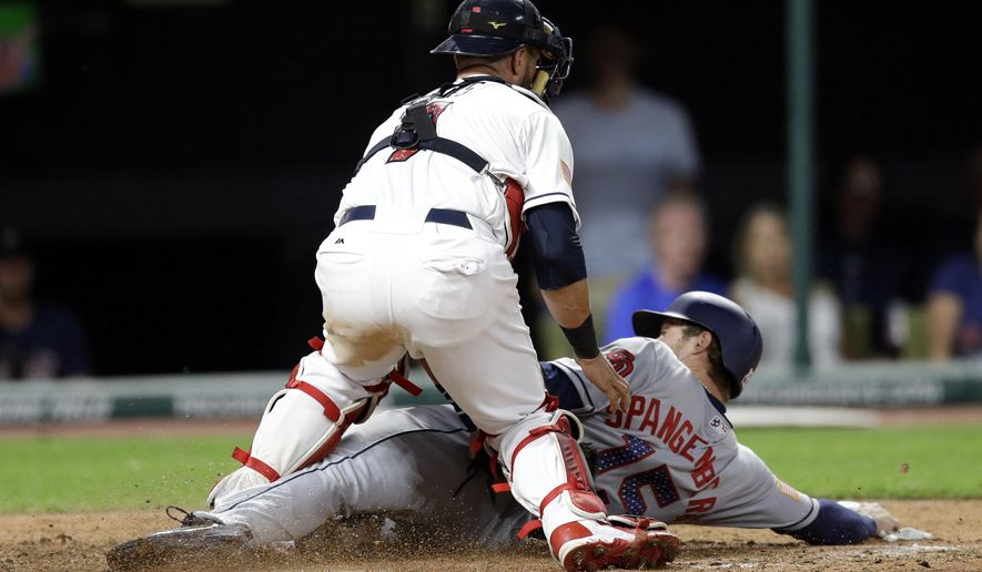 San Diego Padres' Cory Spangenberg is tagged out at home plate by Cleveland Indians catcher Yan Gomes in the eighth inning of a baseball game, Tuesday, July 4, 2017, in Cleveland. (AP Photo/Tony Dejak)