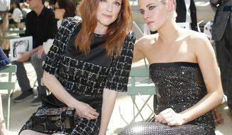 Actresses Julianne Moore, left, and Kristen Stewart pose for photographers prior to the Chanel Haute Couture Fall/Winter 2017/2018 fashion collection presented in Paris, on Tuesday, July 4, 2017 in Paris. (AP Photo/Thibault Camus)