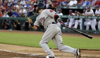 Boston Red Sox's Dustin Pedroia follows through on a two-run single in the second inning of a baseball game against the Texas Rangers on Monday, July 3, 2017, in Arlington, Texas. Sam Travis and Deven Marrero scored on the hit. (AP Photo/Tony Gutierrez)