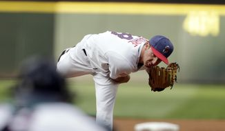 Seattle Mariners starting pitcher Andrew Moore works against the Kansas City Royals during the first inning of a baseball game, Monday, July 3, 2017, in Seattle. (AP Photo/John Froschauer)