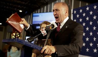 FILE- In this Dec. 10, 2016, file photo, Republican candidate Clay Higgins, with his wife, Becca, addresses supporters after his victory in Louisiana's 3rd congressional district run-off election in Lake Charles, La. Officials at the Auschwitz-Birkenau Memorial and Museum have criticized Clay Higgins for narrating part of a five-minute video from inside a former gas chamber at the Nazi concentration camp in Poland. Louisiana news outlets report that Clay Higgins posted the video Saturday, July 1, 2017. (Lee Celano/The Daily Advertiser via AP, File)