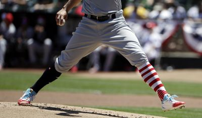 Chicago White Sox starting pitcher James Shields wears Fourth of July-themed stockings as he throws to the Oakland Athletics during the first inning of a baseball game Tuesday, July 4, 2017, in Oakland, Calif. (AP Photo/Marcio Jose Sanchez)