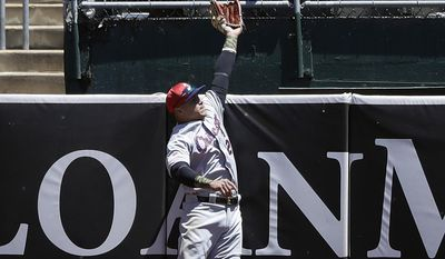 Chicago White Sox right fielder Avisail Garcia leaps but can't catch a home run ball from Oakland Athletics' Yonder Alonso during the fourth inning of a baseball game Tuesday, July 4, 2017, in Oakland, Calif. (AP Photo/Marcio Jose Sanchez)