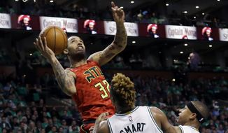 FILE - In this April 28, 2016 file photo, Former Atlanta Hawks forward Mike Scott (32) goes up to shoot against Boston Celtics guards Marcus Smart (36) and Isaiah Thomas (4) during the third quarter in Game 6 of a first-round NBA basketball playoff series in Boston. Free-agent forward Mike Scott has agreed to a $1.7 million, one-year contract with the Washington Wizards, according to a person familiar with the deal.   (AP Photo/Elise Amendola)