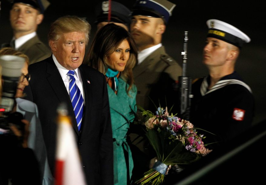 LED IN: President Trump, right and the first lady Melania Trump walk past the honor guards as they arrive to Warsaw, Poland, Wednesday, July 5, 2017. President Donald Trump is back to Europe hoping to receive a friendly welcome in Poland despite lingering skepticism across the continent over his commitment to NATO, his past praise of Russian President Vladimir Putin and his decision to pull the U.S. out of a major climate agreement. (AP Photo/Czarek Sokolowski) (Associated Press)