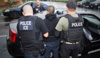In the interior, deportations are down this fiscal year, but arrests by U.S. Immigration and Customs Enforcement are up, as are orders of removal issued by immigration courts in the Justice Department. (Associated Press/File)