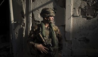 An Iraqi Special Forces soldier stands in position in an alley as Iraqi forces continue their advance against Islamic State militants in the Old City of Mosul, Iraq, Wednesday, July 5, 2017. Some 300 Islamic State fighters remain in the small patch of territory still controlled by the group in Mosul's Old City, a senior Iraqi commander said Wednesday. (AP Photo/Felipe Dana)