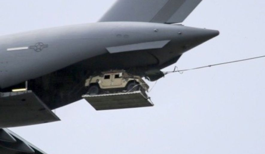 A Humvee is dropped from an Air Force transport plane. (Image: U.S. Air Force)