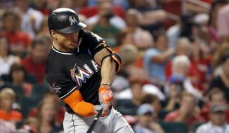 Miami Marlins' Giancarlo Stanton singles during the fourth inning of a baseball game against the St. Louis Cardinals Wednesday, July 5, 2017, in St. Louis. (AP Photo/Jeff Roberson)