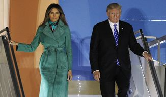 President Donald Trump and the first lady Melania Trump exit Air force One upon their arrival in Warsaw, Poland, Wednesday, July 5, 2017. President Trump arrived in Poland ahead of an outdoor address in Warsaw on Thursday and energy talks with European leaders. (AP Photo/Czarek Sokolowski)