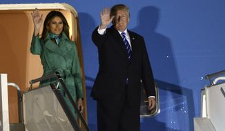 President Trump and the first lady Melania Trump wave from the Air Force One upon their arrival Warsaw, Poland, Wednesday, July 5, 2017. Trump arrived in Poland ahead of an outdoor address in Warsaw on Thursday and energy talks with European leaders. (AP Photo/Alik Keplicz)