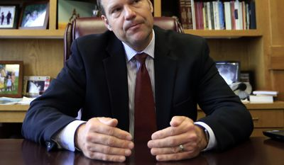 "Kansas Secretary of State Kris Kobach talks with a reporter in his office in Topeka on May 17, 2017. Kobach, the vice chair of President Donald Trump's election fraud commission, is taking issue with reports that a majority of states are refusing to comply with a request for voter information. Kobach says that news stories stating that 44 states have ""refused"" to provide voter information to the commission are ""patently false."" (Associated Press) **FILE**"