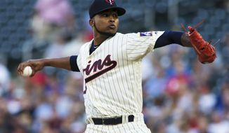 Minnesota Twins starting pitcher Ervin Santana pitches during the first inning of a baseball game against the Los Angeles Angels, Wednesday, July 5, 2017, in Minneapolis. (AP Photo/Paul Battaglia)
