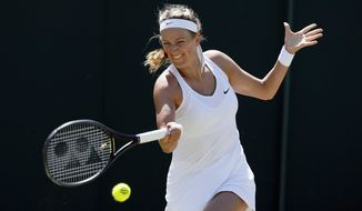 Victoria Azarenka of Belarus returns to Russia's Elena Vesnina during their Women's Singles Match on day three at the Wimbledon Tennis Championships in London Wednesday, July 5, 2017. (AP Photo/Kirsty Wigglesworth)