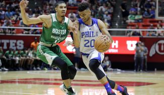 Philadelphia 76ers forward Timothe Luwawu-Cabarrot (20) drives as Boston Celtics forward Jayson Tatum (11) defends during the first half of an NBA summer league basketball game Monday, July 3, 2017, in Salt Lake City. (AP Photo/Rick Bowmer)