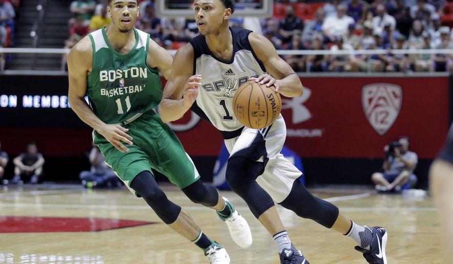 San Antonio Spurs guard Bryn Forbes, right, drives around Boston Celtics forward Jayson Tatum during the second half of an NBA summer league basketball game Wednesday, July 5, 2017, in Salt Lake City. (AP Photo/Rick Bowmer)