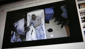In this Thursday, June 29, 2017, photo, a video clip shows China's jailed Nobel Peace laureate Liu Xiaobo lying on a bed receiving medical treatment at a hospital on a computer screen in Beijing. China says it has invited U.S. and German liver cancer experts to join a medical team treating imprisoned Liu. The judicial bureau for the northeastern city of Shenyang said Wednesday, July 5, 2017, in an online statement that Liu's family members made a request for foreign experts and Liu's medical team agreed. (AP Photo/Andy Wong)