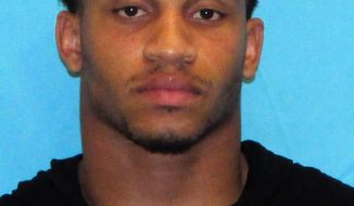 This booking photo provided by the Frisco Police Department shows Damien Wilson. Police say Wilson, a Dallas Cowboys linebacker, has been arrested on two counts of aggravated assault with a deadly weapon. Frisco police say Wilson was arrested Tuesday, July 5, 2017, outside of Toyota Stadium during the city's Fourth of July celebration.  (Frisco Police Department via AP)