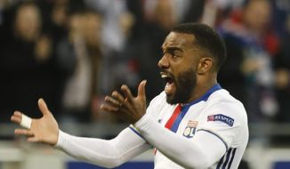 "FILE - A Thursday, May 11, 2017 file photo of Lyon's Alexandre Lacazette reacting after his team scored their side's third goal during the second leg semi final soccer match between Olympique Lyon and Ajax in the Stade de Lyon, Decines, France. Arsenal signaled its intention to make an immediate return to the Premier League's elite by signing Lyon striker Alexandre Lacazette, one of Europe's most prolific players in recent years. Arsenal said on its website Wednesday that the 26-year-old Lacazette ""has agreed to join us on a long-term contract, for an undisclosed fee."" (AP Photo/Laurent Cipriani, File)"