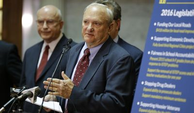 FILE - In this Jan. 5, 2016, Sen. Luke Kenley, R-Noblesville, center, speaks during a news conference at the Statehouse in Indianapolis. Kenley, one of Indiana's most influential state lawmakers, is stepping down after 25 years in the Legislature. The Senate Appropriations Committee chairman announced Wednesday, July 5, 2017, that he would retire effective Sept. 30. (AP Photo/Michael Conroy, File)