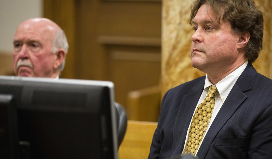 FILE - In this Jan. 9, 2017, file photo, Texas businessman Robert Rhodes, right, faces a judge with his attorney Joseph Cahill in Polk County District Court in Des Moines, Iowa. After Rhodes collected a Wisconsin Lottery jackpot that had been rigged by his friend, he used the windfall for an investment scheme that produced another wave of undeserved government money, court records show. (Rodney White/The Des Moines Register via AP, File)