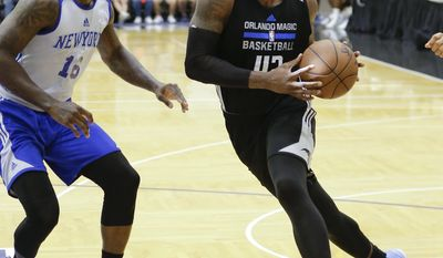 Orlando Magic's Hassan Martin, right, makes a move to get around New York Knicks' Dominique Jones (16) during the second half of an NBA summer league basketball game, Wednesday, July 5, 2017, in Orlando, Fla. (AP Photo/John Raoux)