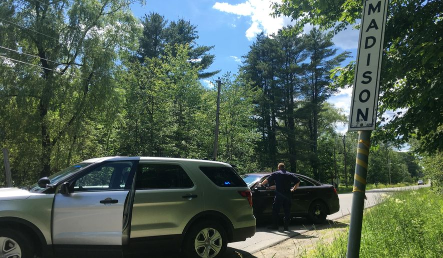 State police in Madison, Maine, have closed the country road Wednesday, July 5, 2017, where a series of Wednesday shootings left three victims dead and one injured. A gunman killed multiple people and wounded another Wednesday morning before being fatally shot by deputies, authorities said. It was Maine's deadliest shooting since 2015. (AP Photo/Marina Villeneuve)