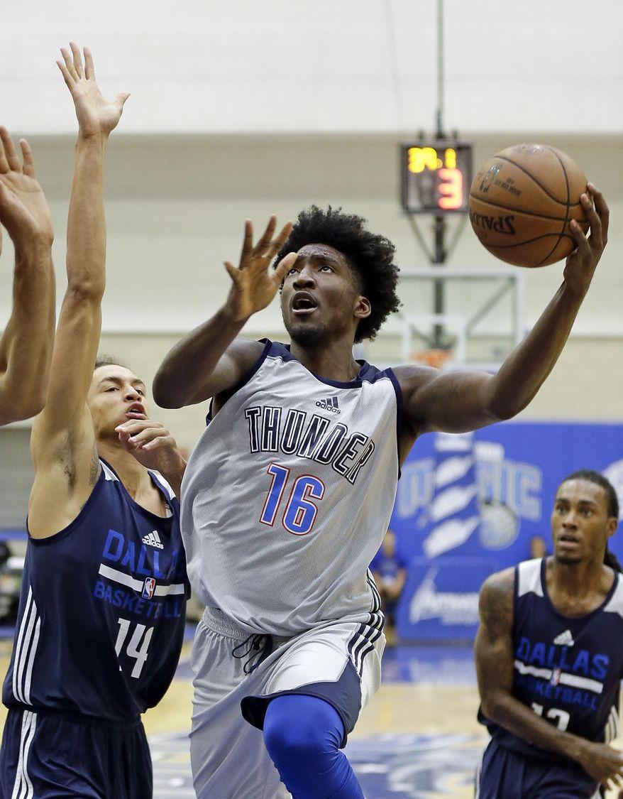 Oklahoma City Thunder's Rashawn Thomas (16) goes in for a shot against Dallas Mavericks' Ismael Bako (14) during the second half of an NBA summer league basketball game, Wednesday, July 5, 2017, in Orlando, Fla. (AP Photo/John Raoux)