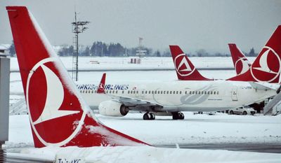 FILE- In this Jan. 10, 2017 file photo, Turkish Airlines aircrafts are stationed at Ataturk International Airport covered in snow, in Istanbul, Tuesday. Istanbul-based Turkish Airlines tweeted early Wednesday that it had been exempted from a ban on laptops in airplane cabins. (Faik Kaptan/Depo Photos via AP, File)