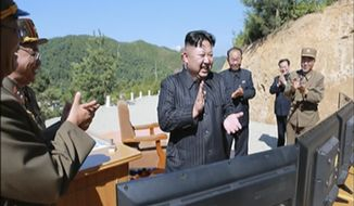 This image made from video of a news bulletin aired by North Korea's KRT on Tuesday, July 4, 2017, shows what was said to be North Korea leader Kim Jung Un, center, applauding after the launch of a Hwasong-14 intercontinental ballistic missile, ICBM, in North Korea's northwest. Independent journalists were not given access to cover the event depicted in this photo. Keeping North Korea from having a nuclear-armed intercontinental ballistic missile has long been considered a key U.S. red line; and one Pyongyang has thumbed its nose at for years. Its Fourth of July ICBM launch is just the latest step in its long march toward, and maybe over, that line. (KRT via AP Video)