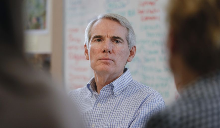 Sen. Rob Portman, R-Ohio, listens during a roundtable discussion with former addiction recovery clients and current employees at the Adams Recovery Center for Women, Wednesday, July 5, 2017, in Cincinnati. Portman discussed the importance of increased funding for addiction treatment and efforts to combat the ovoid epidemic in Ohio. (AP Photo/John Minchillo)