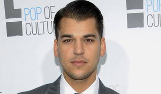 "In this April 30, 2012, file photo, Rob Kardashian from the show ""Keeping Up With The Kardashians"" attends an E! Network upfront event in New York. Kardashian said Instagram shut down his page on Wednesday, July 5, 2017, following his flurry of posts attacking his former fiancee Blac Chyna. (AP Photo/Evan Agostini, File)"