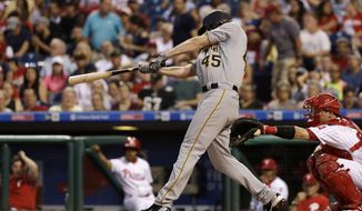 Pittsburgh Pirates' Gerrit Cole follows through on a a two-run single off Philadelphia Phillies starting pitcher Ben Lively during the fourth inning of a baseball game, Wednesday, July 5, 2017, in Philadelphia. At right is catcher Andrew Knapp. (AP Photo/Matt Slocum)