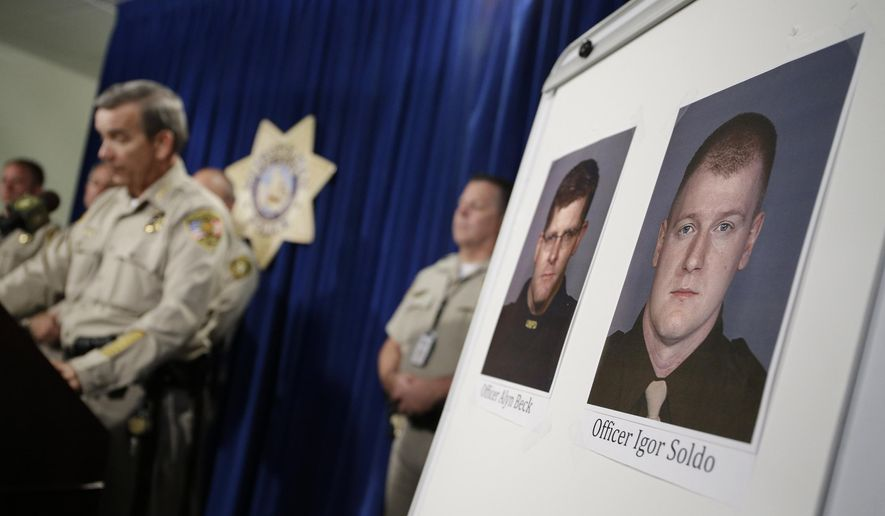 FILE - In this June 8, 2014 file photo, the photos of slain police officers Alyn Beck and Igor Soldo, right, are displayed at a news conference in Las Vegas. Earlier in the day a man and a woman ambushed the wo police officers while they were eating lunch at a Las Vegas pizza restaurant, fatally shooting them before fleeing to a nearby Wal-Mart, where they killed a third person and then themselves in an apparent suicide pact.(AP Photo/John Locher, File)
