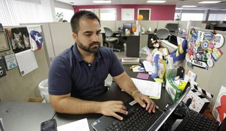 In this Monday, June 26, 2017 photo, Ricardo Negron works at his office in Orlando, Fla., where he runs a community center. Negron, who trained as a lawyer in Puerto Rico, said he doesn't have the time or the money to take off three months to study for the Florida bar exam to practice law. (AP Photo/John Raoux)