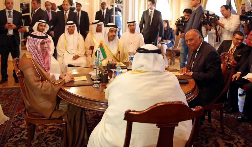 Seated from left to right at table, Saudi Foreign Minister Adel al-Jubeir, United Arab Emirates Foreign Minister Abdullah bin Zayed al-Nahyan, Egyptian Foreign Minister Sameh Shoukry, and Bahraini Foreign Minister Khalid bin Ahmed al-Khalifa meet in Cairo, Egypt, Wednesday, July 5, 2017. The foreign ministers from four Arab nations that have sought to isolate Qatar over its alleged support for extremist groups started talks Wednesday, hours after the quartet said they had received Qatar's response to their demands for ending the crisis. (Khaled Elfiqi, Pool, via AP)