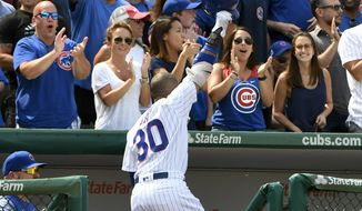 Chicago Cubs Jon Jay (30) greets the crowd after he hit a three run home run during the sixth inning of a baseball game against the Tampa Bay Rays on Wednesday, July 5, 2017, in Chicago. (AP Photo/Matt Marton)