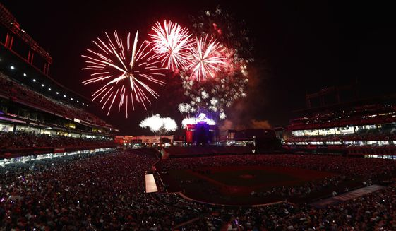 Fireworks explode over Coors Field during an Independence Day celebration after the Colorado Rockies hosted the Cincinnati Reds in a baseball game Tuesday, July 4, 2017, in Denver. The Reds won 8-1. (AP Photo/David Zalubowski)