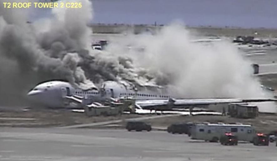 This July 6, 2013, image made from a San Francisco International Airport video shows Asiana flight 214 after it crashed at the airport in San Francisco. The video shows the fiery 2013 crash of a commercial airliner on approach at San Francisco International Airport. (San Francisco International Airport via AP)