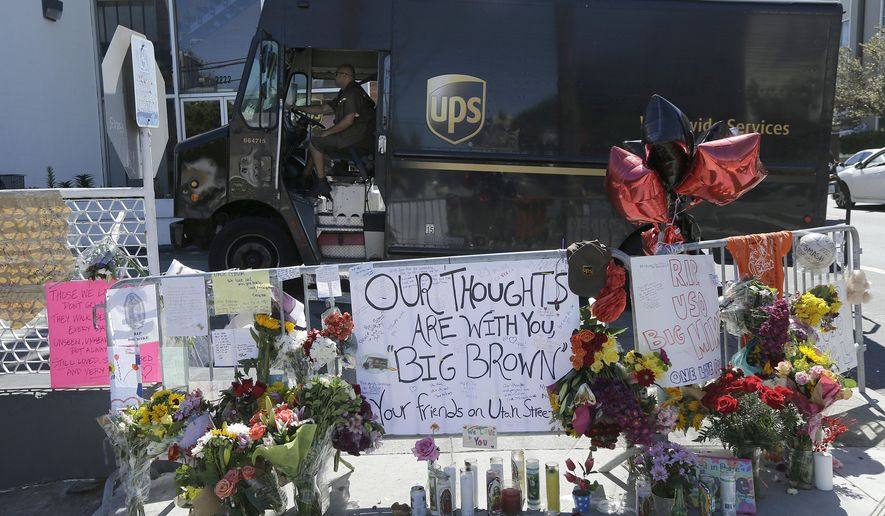 FILE - In this June 16, 2017 file photo, a UPS truck is driven past a memorial set up outside of a UPS facility in San Francisco. A union official says only five of the 40 San Francisco UPS workers have returned to work after witnessing the fatal shootings of three colleagues last month. (AP Photo/Jeff Chiu, file)
