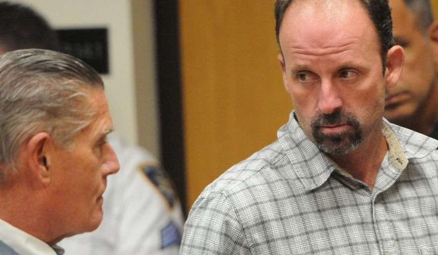 FILE - In this July 31, 2014 file photo, John Bittrolff, right, listens to his attorney William Keahon during his arraignment on murder charges in Riverhead, N.Y. On Wednesday, July 5, 2017, a Long Island jury convicted Bittrolff of murder in the deaths of two prostitutes found slain in the 1990s. (James Carbone/Newsday via AP, Pool, File)
