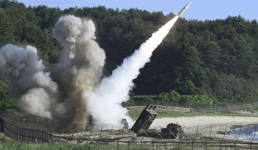 """In this photo provided by South Korea Defense Ministry, a U.S. MGM-140 Army Tactical Missile is fired during the combined military exercise between the U.S. and South Korea against North Korea at an undisclosed location in South Korea, Wednesday, July 5, 2017. Grinning broadly, North Korean leader Kim Jong Un delighted in the global furor created by his nation's first launch of an intercontinental ballistic missile, vowing Wednesday to never abandon nuclear weapons and to keep sending Washington more """"gift packages"""" of missile and atomic tests. (South Korea Defense Ministry via AP)"""