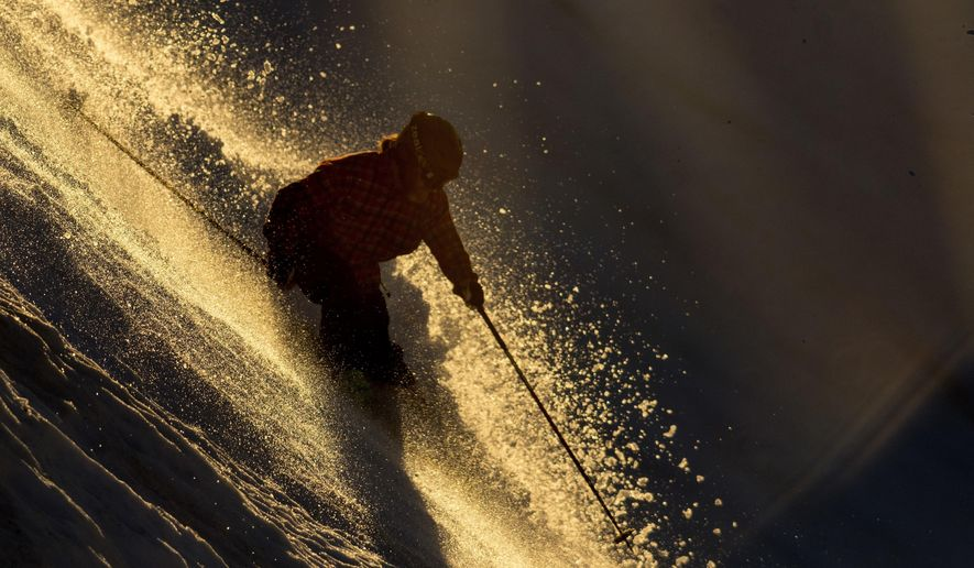 A skiier heads down the advanced skiier only slope at the Bearstooth Basin Summer Ski Area in the Bearstooth Mountain Range in northern Wyoming on Thursday, June 21, 2017. (Mark Davis/The Powell Tribune via AP)