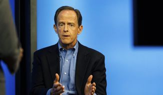 Sen. Pat Toomey takes part in a TV town hall in the Harrisburg, Pa., studios of WHTM-TV, Wednesday, July 5, 2017. (James Robinson/PennLive.com via AP) ** FILE **