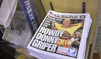 Copies of the New York Post with an illustration of President Donald Trump as a professional wrestler on the front page are displayed at a newsstand in New York City, Monday, July 3, 2017. On Sunday, Trump's apparent fondness for wrestling emerged in a tweeted mock video that shows him pummeling a man in a business suit with his face obscured by the CNN logo. (AP Photo/Richard Drew)
