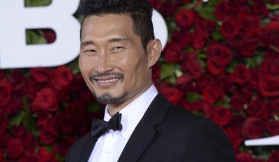 """FILE - In this June 12, 2016, file photo, Daniel Dae Kim arrives at the Tony Awards at the Beacon Theatre in New York.  Kim said in a Facebook post Wednesday, July 5, 2017, his decision to leave """"Hawaii Five-O"""" stemmed from a contract dispute. (Photo by Charles Sykes/Invision/AP, File)"""
