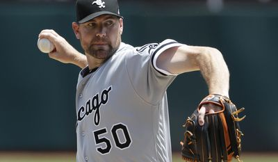 Chicago White Sox starting pitcher Mike Pelfrey throws to the Oakland Athletics during the second inning of a baseball game Wednesday, July 5, 2017, in Oakland, Calif. (AP Photo/Marcio Jose Sanchez)