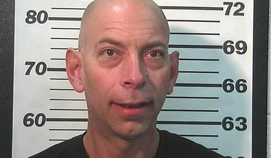 This undated photo provided by the Summit County Sheriff's office shows Jason Stone. Utah police arrested Stone on Monday, July 3, 2017, in connection with a woman that was held against her will, repeatedly beat and wrapped in a blanket held together by duct tape. (Summit County Sheriff's Office via AP)